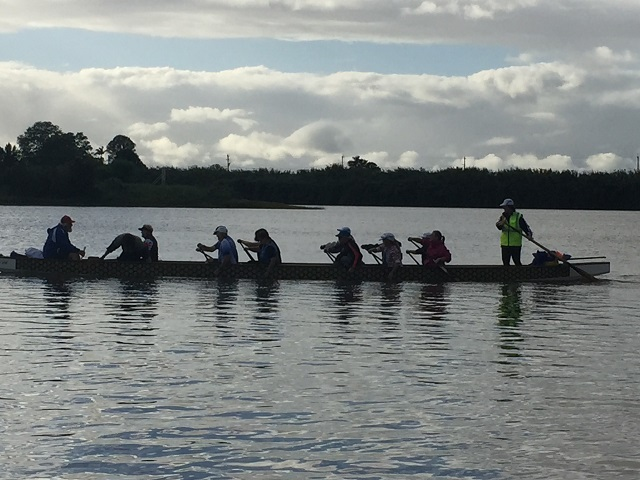 The Dragon boat crew out for early morning practice.