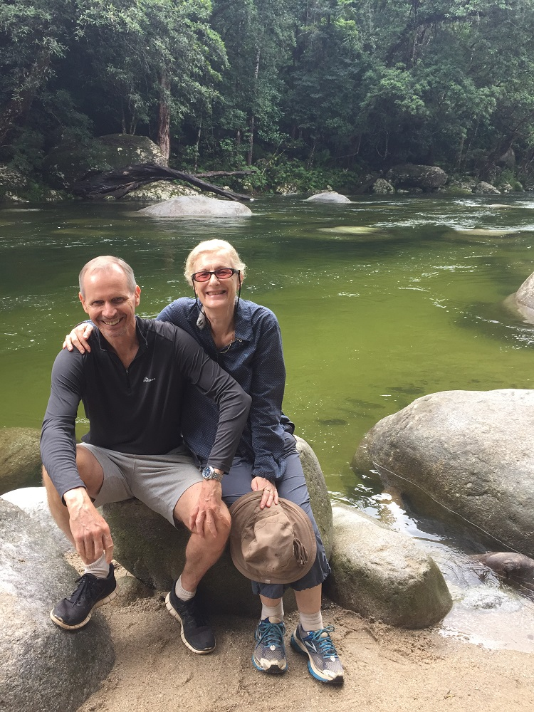 Ric and Gill with the icy cold fast flowing waters of Mossman Gorge behind them.