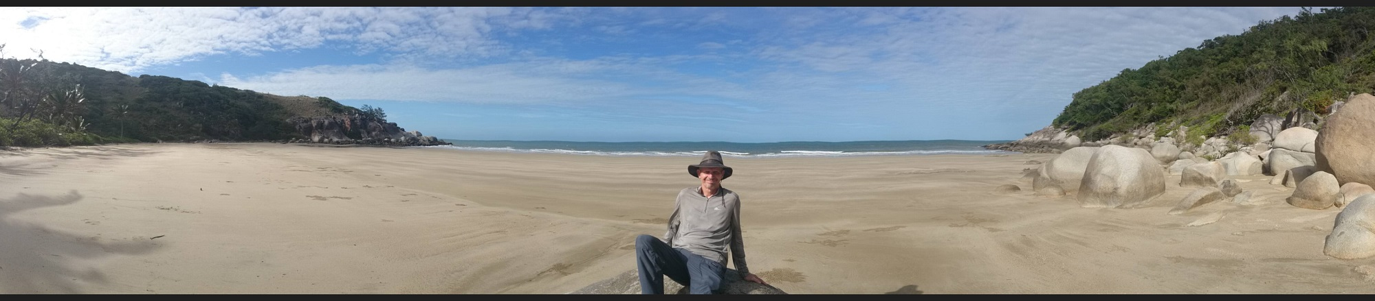 Ric, posing on a beautiful secluded beach.