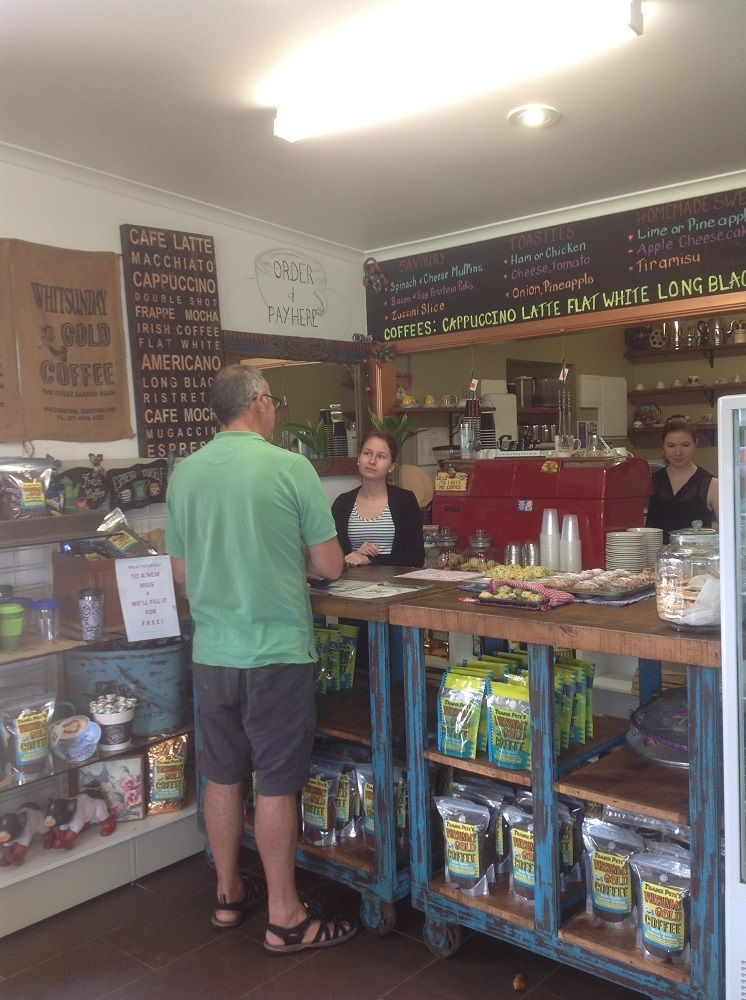 Buying a delicious coffee at Whitsunday Gold - and those fresh muffins there on the counter were divine.