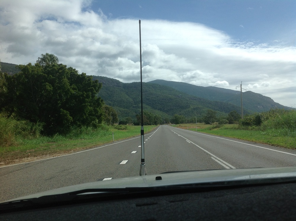 You know you're in the tropics when you see that lush countryside, mountains and building clouds.