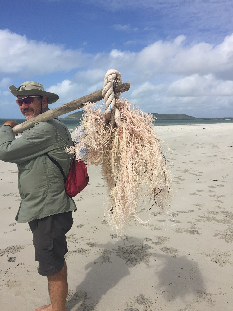 Helping clean up Chilli Beach.