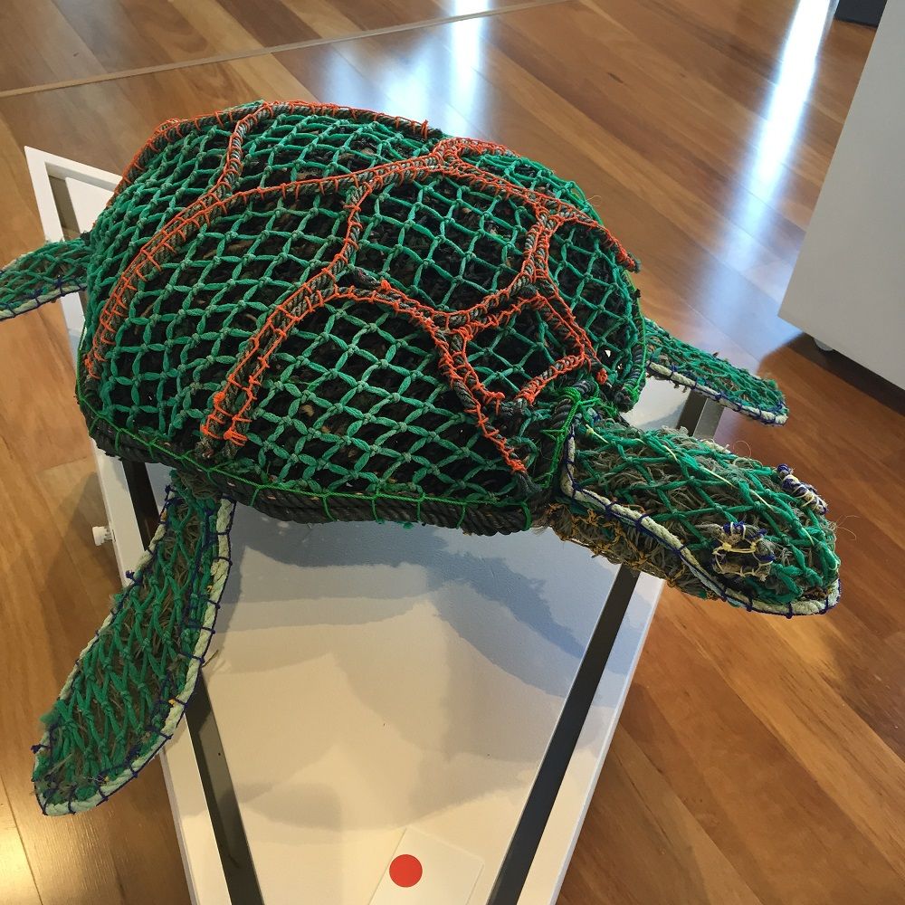 Turtle fashioned from the deadly ghost nets that kill them. Displayed in the Art Centre.