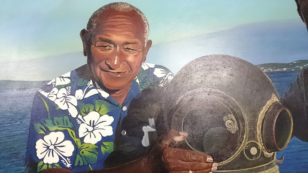 Painting of Seaman Dan with his diving helmet.