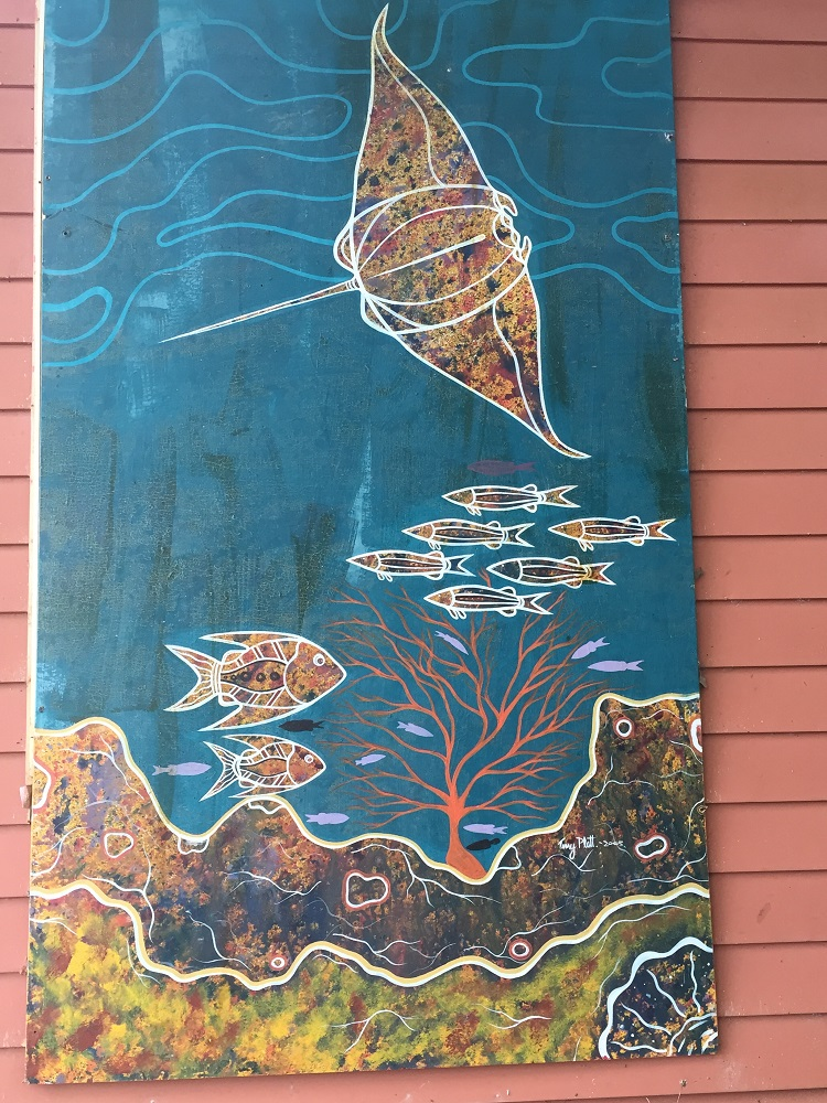 Public art, on the wall of the Lockhart River Arts centre