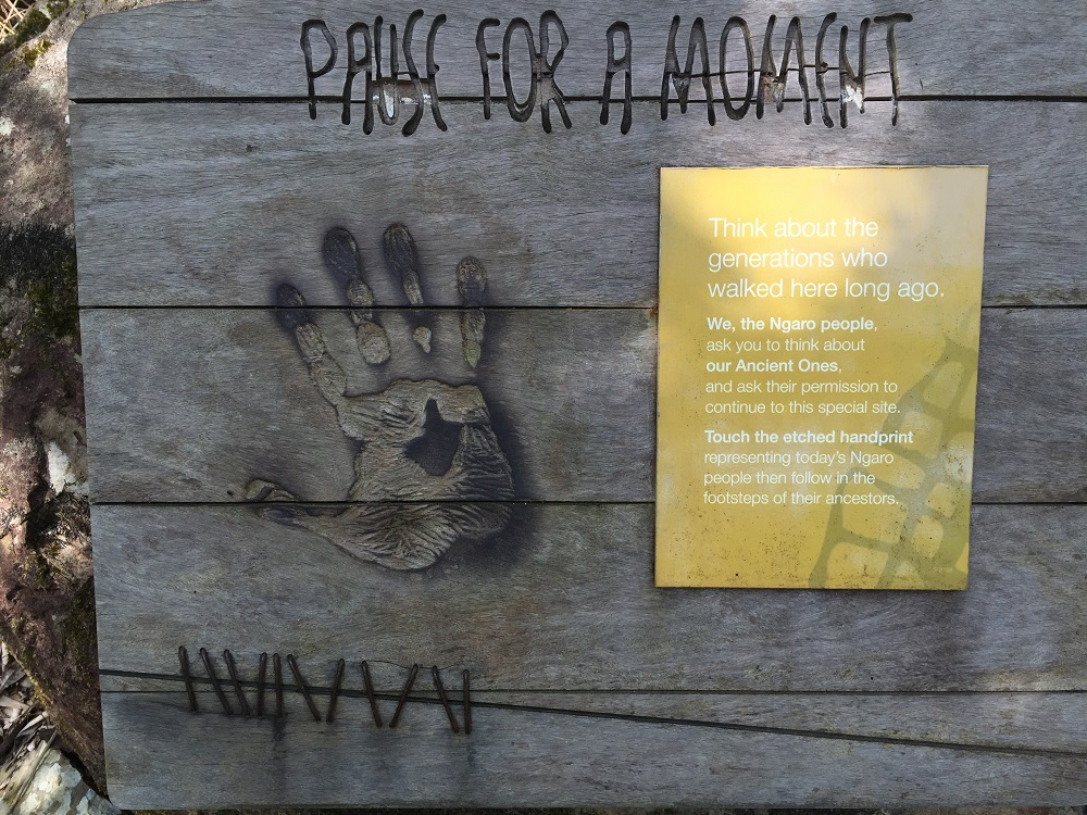 In aboriginal culture it is common to ask their ancestors for permission before entering certain sites. This sign asks the visitor to pause and think about the people who walked here before them and acknowledge the Ancient Ones by putting your hand over the handprint.