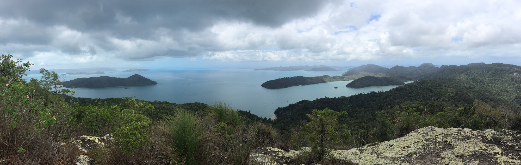 The view north from Whitsunday Peak. Cid Island on the left, Cid Harbour the protected area between the island and the headland jutting out from the right.