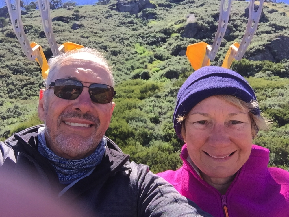 Hmm haven't quite mastered the art of the selfie. Clamps to attach mountain bikes to the ski lift behind our heads.