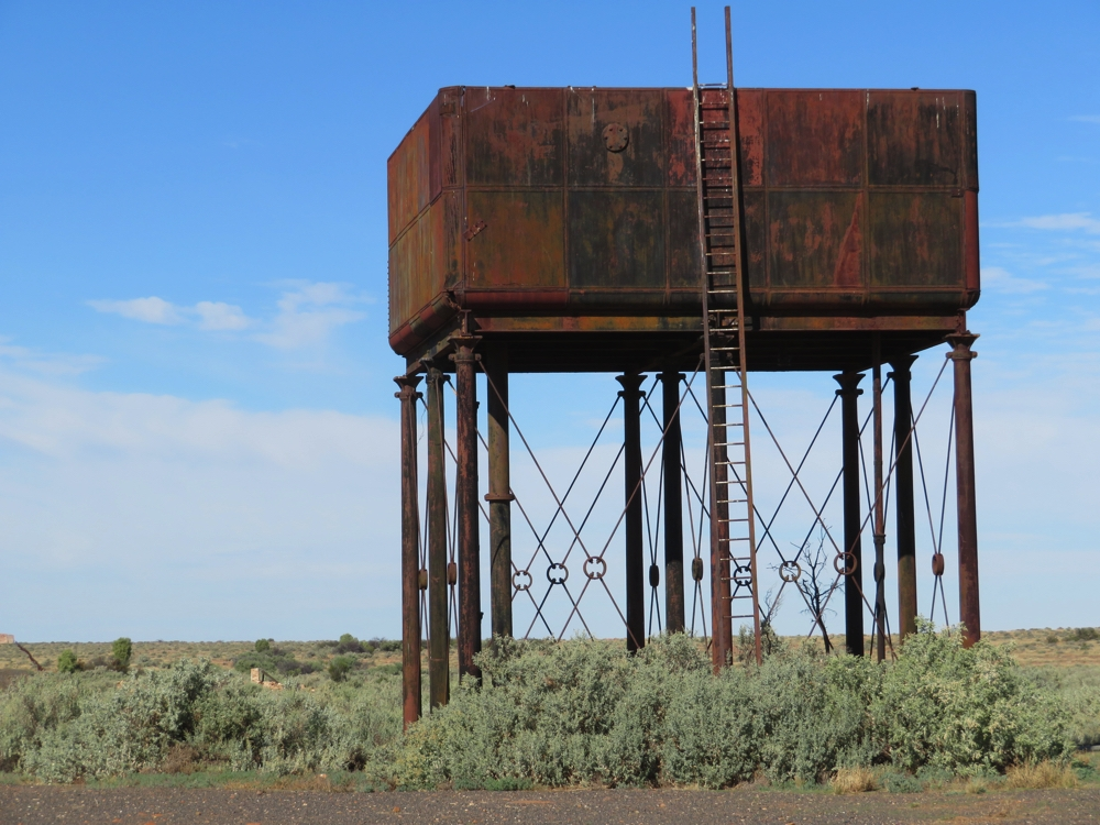 The water tower at Farina railway siding. This style of cast iron tank is common at the Ghan sidings - the water being used to refill the steam engines.