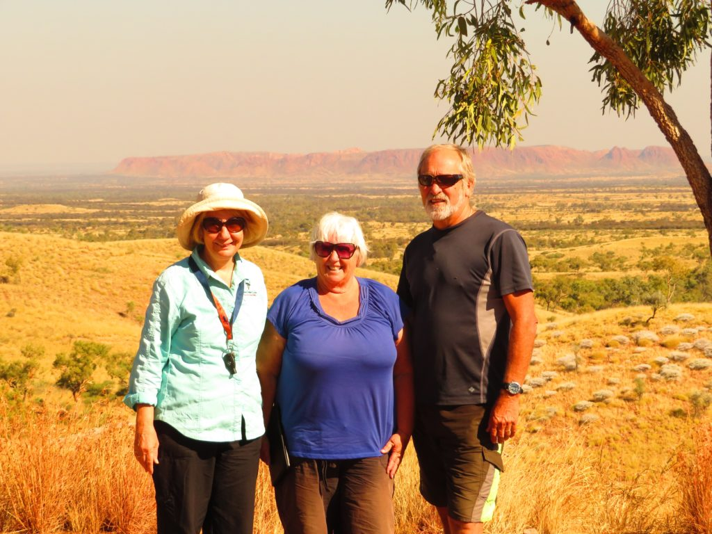 Posing at Tylers Pass with Gosses Bluff in the background. Denise, Wendy, Ken.