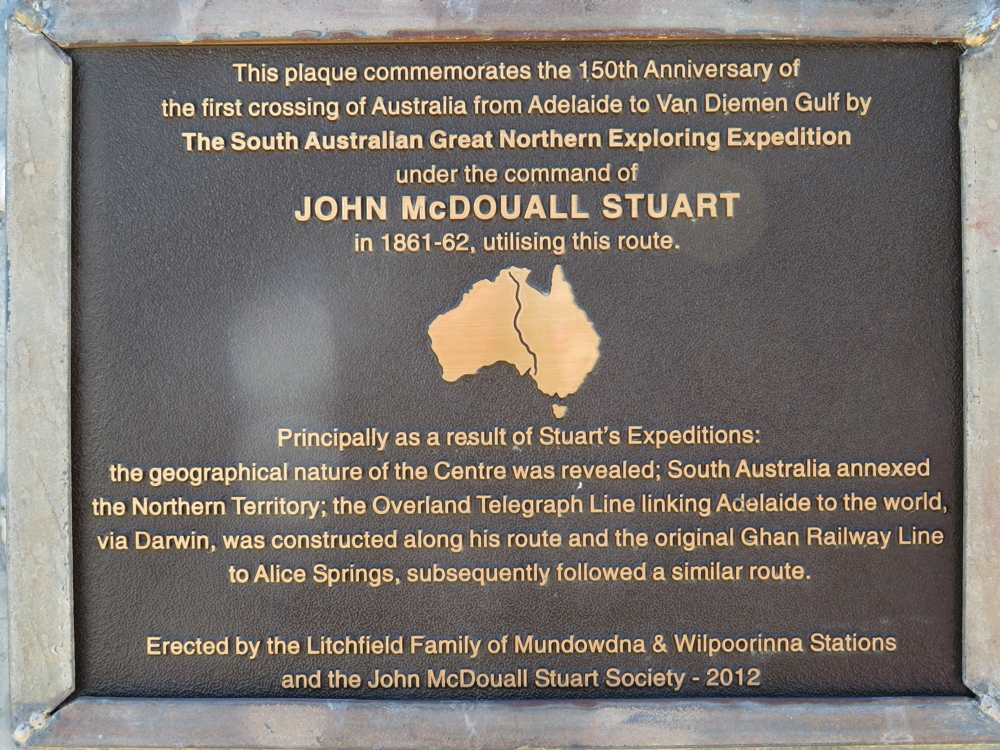 Stuart's contribution to opening up central Australia is commemorated. His expeditions permitted not only communication from south to north, but also settlements and farming.