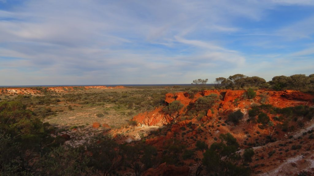 Sunrise on the beautiful red cliffs of Giles Breakaway.