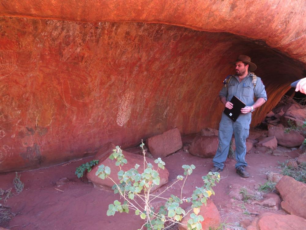 Explaining the ways of the indigenous people who lived here - on the Mala walk.Uluru