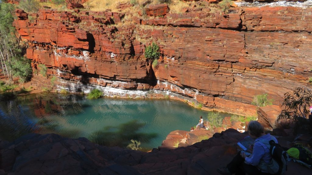 Relaxing on the naturally formed slab seating around Fortescue pool. Dales Gorge.